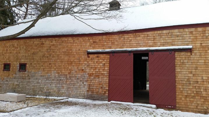 Cedar shingles on 3 bay English style barn at 201 Larch Row  in Wenham