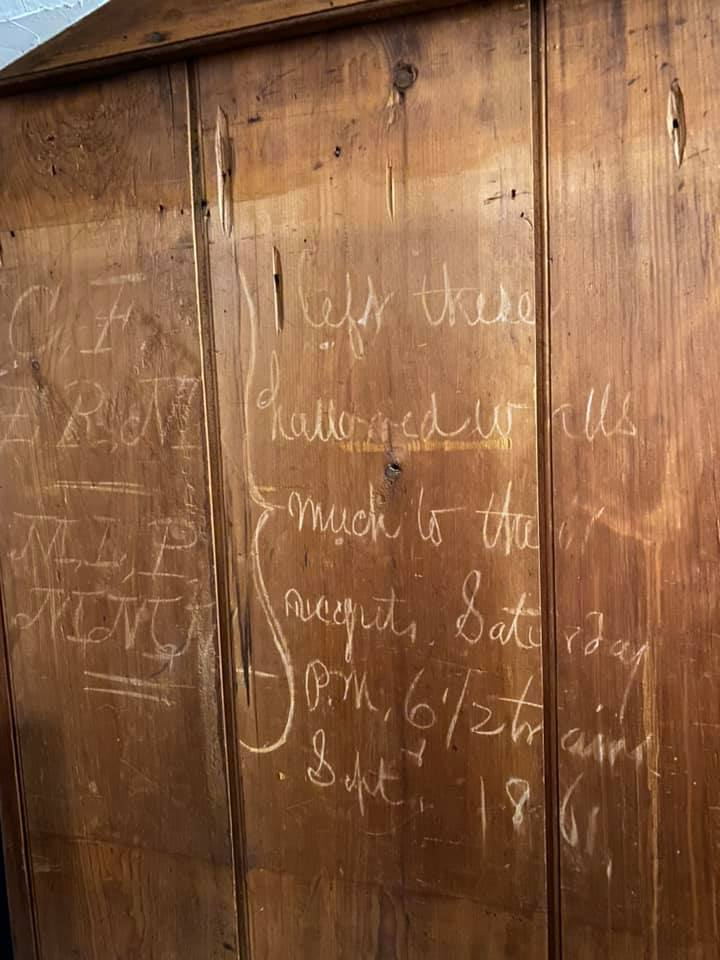 Inscriptions on the wall of the Perley house at 100 Main St. in Rowley.