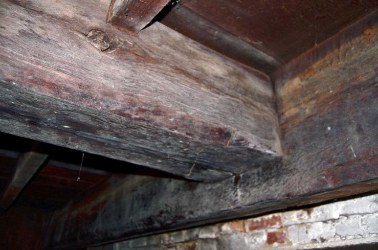 Summer beam intersecting transverse beam at fireplace, 30 East St., Ipswich