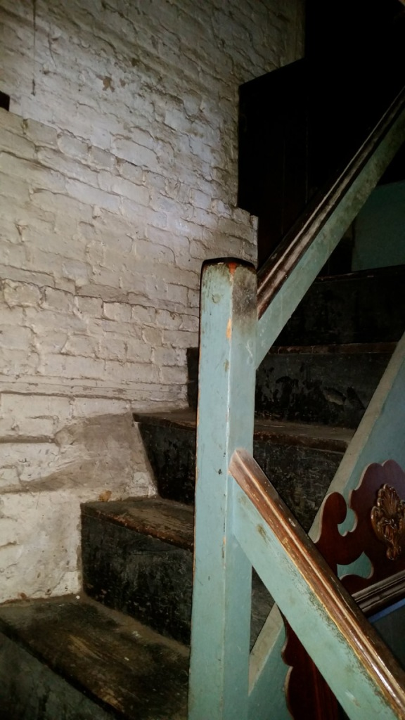 Stair post, winder and chimney block at front entrance, 30 East St., Ipswich MA