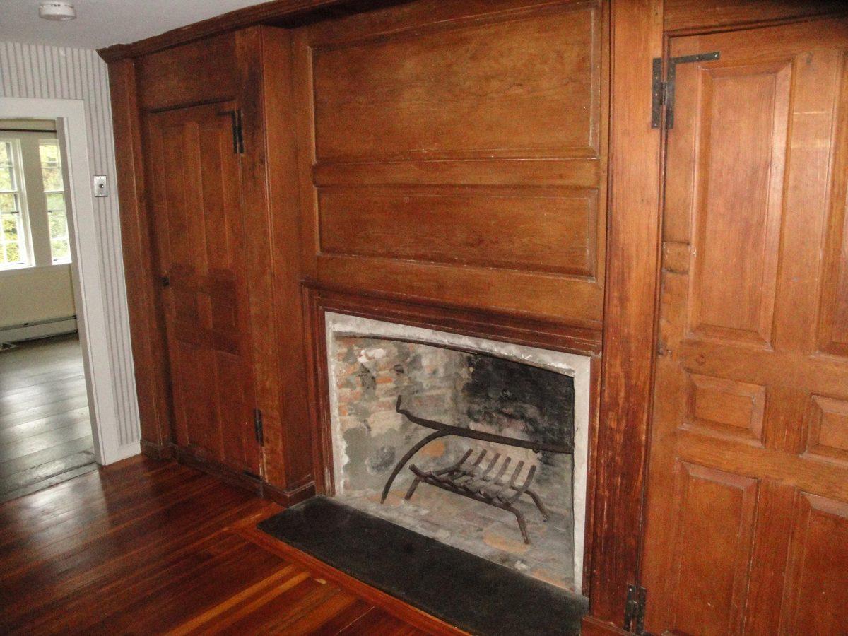 Pine paneling, doors and fireplace at 153 Perkins Row